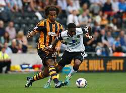 Hull City's Tom Huddlestone tackles Norwich City's Leroy Fer   - Photo mandatory by-line: Matt Bunn/JMP - Tel: Mobile: 07966 386802 24/08/2013 - SPORT - FOOTBALL - KC Stadium - Hull -  Hull City V Norwich City - Barclays Premier League