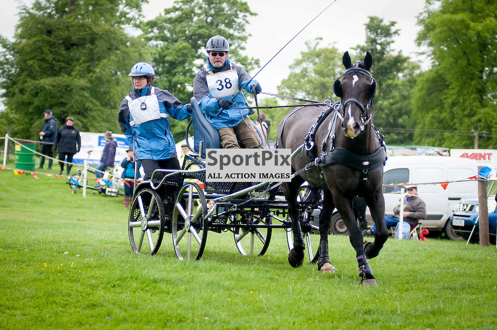 His Royal Highness, Prince Phillip, The Duke of Edinburgh, was attending the 2014 Hopetoun Horse Driving Trails. Hamish Reid in action. Saturday, 24th May, 2014. (c) Wullie Marr | SportPix.org.uk