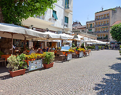 Pedestrians-only lanes lined with tiny shops and eateries radiate off Piazza Cadorna in Stresa, a prime tourism hub on the western shore of Lake Maggiore, Italy.