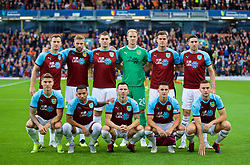 BURNLEY, ENGLAND - Thursday, August 16, 2018: Burnley players line-up for a team group photograph before the UEFA Europa League Third Qualifying Round 2nd Leg match between Burnley FC and İstanbul Başakşehir at Turf Moor. Ashley Barnes, Charlie Taylor, Sam Vokes, goalkeeper Joe Hart, Kevin Long, Stephen Ward. Front row L-R: Jeff Hendrick, Aaron Lennon, Phil Bardsley, Ashley Westwood, Ben Gibson. (Pic by David Rawcliffe/Propaganda)