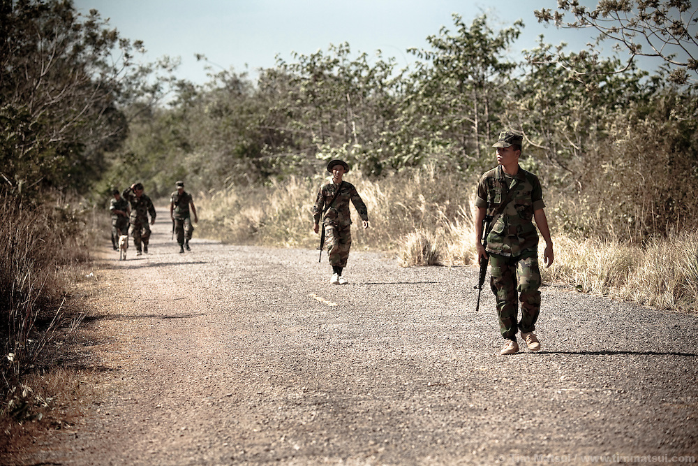 """Thai military patrol their side of the """"White Zone,"""" a heavily mined buffer between Cambodia and Thailand through which undocumented migrants regularly pass."""