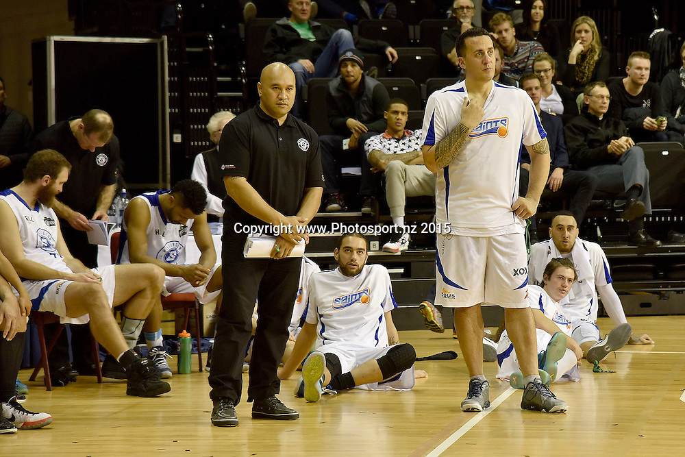 The Saints sit dejected after their loss during the NBL final basketball match between Wellington Saints and Southland Sharks at the TSB Arena in Wellington on Sunday the 5th of July 2015. Copyright photo by Marty Melville / www.Photosport.nz