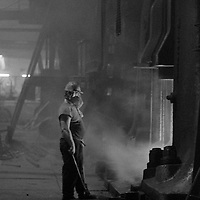 Forge hand on the nightshift at George Turton Platts drop forge Furnival Street, Sheffield. 29 July 1981