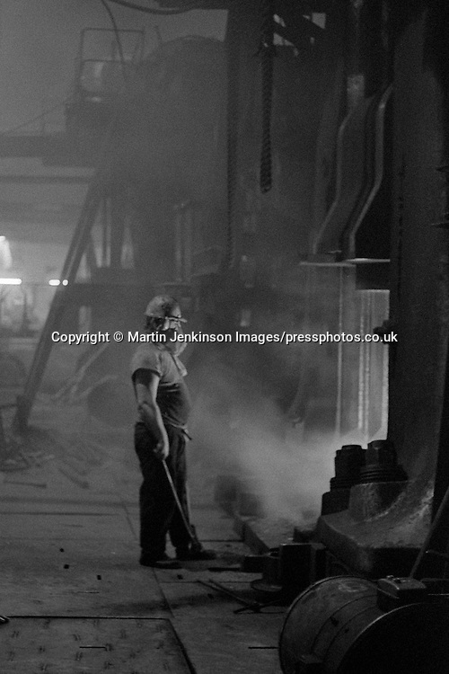 Forge hand at George Turton Platts drop forge Furnival Street, Sheffield. 29 July 1981