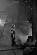 Forge hand at George Turton Platts drop forge Furnival Street, Sheffield. 29 July 1981