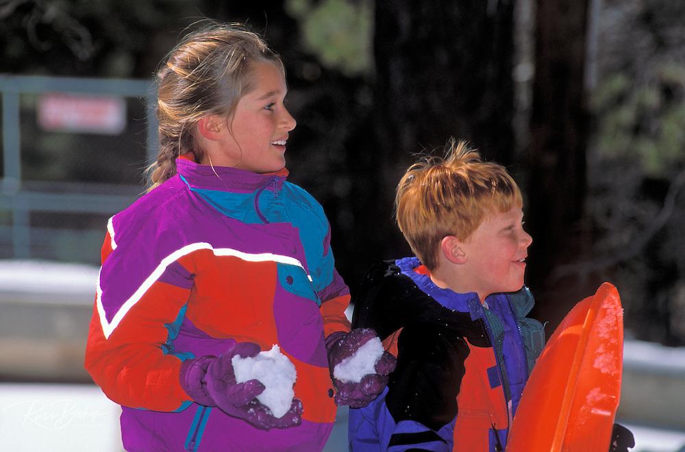 Kids (ages 8 & 10) having a snow ball fight, San Bernardino National Forest, California