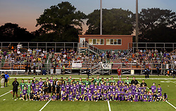 09 May 2015. New Orleans, Louisiana.<br /> New Orleans Jesters. Jesters Academy players join the senior squad for a team photo on the first game of the season at the Pan American Stadium. <br /> Photo; Charlie Varley/varleypix.com