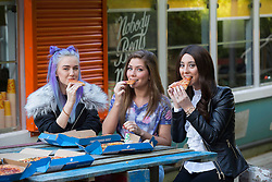 EDITORIAL USE ONLY Megan-Elisabeth Brickles, 17 (left) and Sophie Mulligan, 19 (right), who have both been supported by the Teenage Cancer Trust, meet Hollyoaks actor Nikki Sanderson on the set of the show in Liverpool.