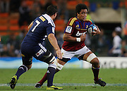 Nasi Manu of the Highlanders on the run with Francois Louw of the DHL Stormers in defense during the Super Rugby (Super 15) fixture between the DHL Stormers and the Highlanders held at DHL Newlands Stadium in Cape Town, South Africa on 11 March 2011. Photo by Jacques Rossouw/SPORTZPICS