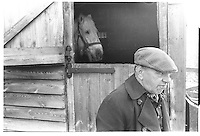 Farrier with horse, Hanwell, London street photography in 1982. Tri-X