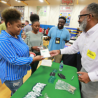 Chip Ashford, right, from BankPlus meets with students about summer jobs as Tupelo High School holds a job fair for their junior and senior class.