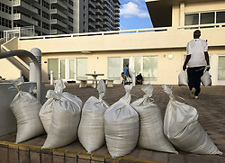 September 8, 2017 - Wildwood, Florida, U.S. - Workers at the Atlantic Ocean Club on Galt Ocean Drive in Fort Lauderdale finish protecting the building with the sand they were shoveling from the beach Friday morning. (Credit Image: © Taimy Alvarez/TNS via ZUMA Wire)