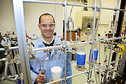 "Brad Rosenheim, Tulane University assistant professor of earth and environmental science, in his lab at Blessey Hall with his ""dirtburner"" machine that he uses for radiocarbon dating/climate change research with rivers and oceans"