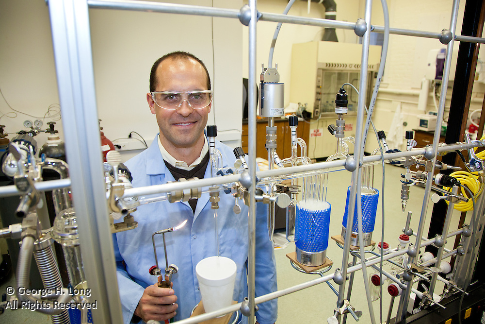"""Brad Rosenheim, Tulane University assistant professor of earth and environmental science, in his lab at Blessey Hall with his """"dirtburner"""" machine that he uses for radiocarbon dating/climate change research with rivers and oceans"""