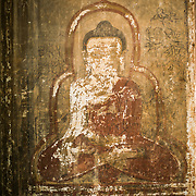 A painting of Gautama Buddha on a wall inside Htilominlo Temple, near Nyaung-U, named after the king of Pagan dynasty of Burma (Myanmar) from 1211 to 1235. His 24-year reign marked the beginning of the gradual decline of Pagan dynasty.