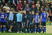 Sheffield Wednesday manager Steve Bruce calms his players down after Sheffield Wednesday forward Fernando Forestieri (45) scored a spectacular equaliser during the EFL Sky Bet Championship match between Norwich City and Sheffield Wednesday at Carrow Road, Norwich, England on 19 April 2019.