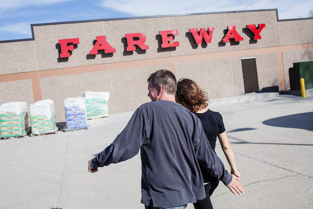 Steve McFarland and Penny Jonhson walk to the grocery store on Friday, March 23, 2012 in Webster City, IA.