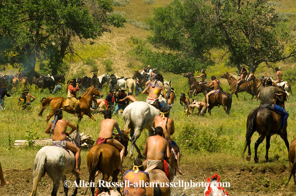Custers Last Stand Reenactment, Battle of the Little Bighorn, Crow Indian Reservation, Montana, Custer and 7th Cavalry battle indian warriors.