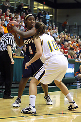 19 March 2010: Philana Greene defended by Michelle Ketcham. The Flying Dutch of Hope College defeat the Yellowjackets of the University of Rochester in the semi-final round of the Division 3 Women's Basketball Championship by a score of 86-75 at the Shirk Center at Illinois Wesleyan in Bloomington Illinois.
