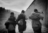 Tibetan Girls Running, Labrang, Amdo, Tibet 1996..