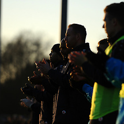 TELFORD COPYRIGHT MIKE SHERIDAN A silhoutte of Gavin Cowan and Telford players and coaches as they observe a minutes applause during the Vanarama Conference North fixture between Darlington and AFC Telford United at Blackwell Meadows on Saturday, November 30, 2019.<br /> <br /> Picture credit: Mike Sheridan/Ultrapress<br /> <br /> MS201920-032