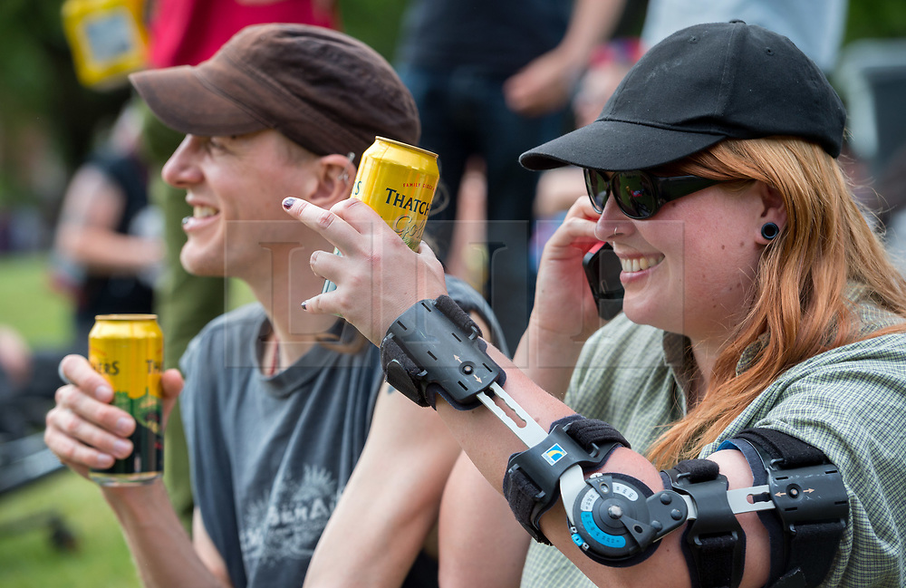 """© Licensed to London News Pictures. 25/05/2019. Bristol, UK. STEVE and CHERYL (no surnames given) with a cans of cider at a """"drink-in"""" protest, organised by Bristol Momentum Youth, held in Bristol's Castle Park against fines under a Public Space Protection Orders (PSPOs) now being implemented by Bristol City Council which are used to ban alcohol drinking in certain areas. Though most of the alcohol in public bans have been in place since late 2017, they weren't actively enforced until this year when contractor 3GS took over the council contract for litter and other rules enforcement in outside spaces from previous contractor Kingdom. The PSPO rule states that: """"No person in the restricted area shall be in possession of any opened or unsealed bottle or container of alcohol"""". The fines can be up to £100 and protestors say it will disproportionately affect the least well off in the community who are also likely be targeted more with the fines in the first place, and is another step in eroding the use of public space. Photo credit: Simon Chapman/LNP."""