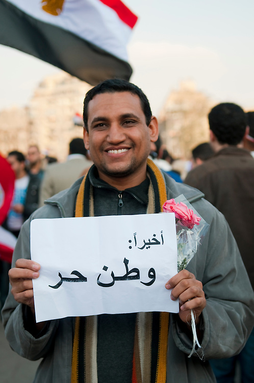 "An Egyptian man in Cairo's Tahrir Square holds a sign that reads: ""Finally: A free country"". This picture was taken the day after Egypt's President, Hosni Mubarak, resigned after 18 days of anti-government demonstrations. (Cairo, Egypt - February 12, 2011)"