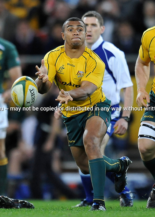 Will Genia passes from the base of the ruck for Australia during action from the Tri-Nations Rugby Test Match played between Australia and South Africa at Suncorp Stadium (Brisbane, Australia) on Saturday 24th July 2010<br /> <br /> Conditions of Use : This image is intended for Editorial use only (news or commentary, print or electronic) - Required Images Credit &quot;Steven Hight - Auraimages/Photosport