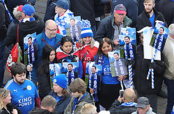 Leicester City fans gather at Jubilee Square in Leicester, before taking part in a memorial walk to the King Power Stadium, in honour of the club's owner Vichai Srivaddhanaprabha and four others who died in a helicopter crash outside the stadium on October 27.