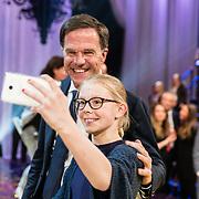 NLD/Amsterdam/20170507 - Gehandicapte Mis(s) verkiezing 2017, premier Mark Rutte maakt een selfie met een fan