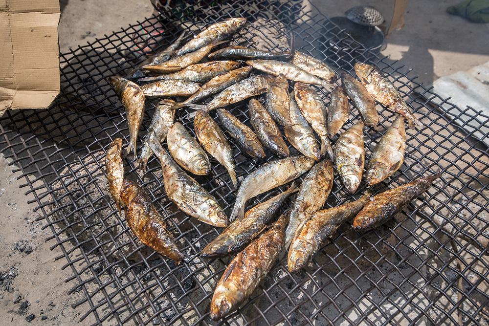 Fish is smoked on fire in Ganta, Liberia