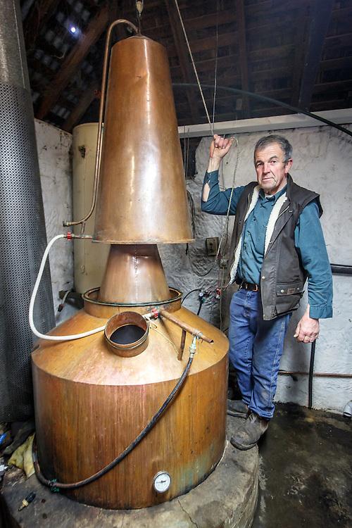 Belgrove Distillery owner Peter Bignell inspects the still at Belgrove Distillery in Kempton, Tasmania, August 25, 2015. Gary He/DRAMBOX MEDIA LIBRARY