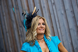 LIVERPOOL, ENGLAND - Thursday, April 6, 2017: Paula Garner from Lymm wearing a peacock dress from American Dress and a home-made fascinator, during The Opening Day on Day One of the Aintree Grand National Festival 2017 at Aintree Racecourse. (Pic by David Rawcliffe/Propaganda)