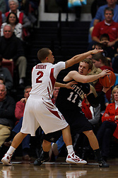 Dec 22, 2011; Stanford CA, USA;  Butler Bulldogs guard Jackson Aldridge (11) is defended by Stanford Cardinal guard Aaron Bright (2) during the first half at Maples Pavilion.  Mandatory Credit: Jason O. Watson-US PRESSWIRE