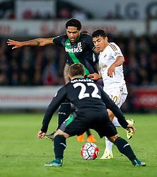 Jefferson Montero of Swansea City is challenged by Glen Johnson and Xherdan Shaqiri of Stoke City - Mandatory byline: Rogan Thomson/JMP - 07966 386802 - 19/10/2015 - FOOTBALL - Liberty Stadium - Swansea, Wales - Swansea City v Stoke City - Barclays Premier League.