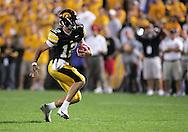 08 SEPTEMBER 2007: Iowa quarterback Ricky Stanzi (12) scrambles in Iowa's 35-0 win over Syracuse at Kinnick Stadium in Iowa City, Iowa on September 8, 2007.