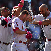 May 13, 2018; Anaheim, CA, USA; Los Angeles Angels third baseman Zack Cozart (center right) is doused with water after hitting a walk-off RBI single during the ninth inning to defeat the Minnesota Twins 2-1 at Angel Stadium of Anaheim. Mandatory Credit: Orlando Ramirez-USA TODAY Sports