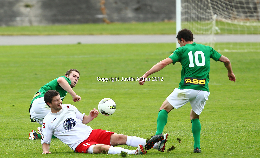 Waitakere's Tim Myers makes a tackle on Manawatu's Adam Cowan. ASB Premiership Football - YoungHeart Manawatu v Waitakere United, Memorial Park, Palmerston North, New Zealand on Sunday 18 November 2012. Photo: Justin Arthur / Photosport.co.nz