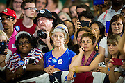Supporters look on as Hillary Clinton, presumptive 2016 Democratic presidential nominee, campaigns with Senator Tim Kaine (D-VA) at Northern Virginia Community College in Annandale, Va., U.S., on Thursday, July 14, 2016. Clinton and the former Virginia Governor discussed their shared commitment to building an America that is stronger together, while emphasizing that Donald Trump's divisive agenda would be dangerous for America. Kaine is considered to be the frontrunner for the Vice Presidential slot. Photographer: Pete Marovich/Bloomberg