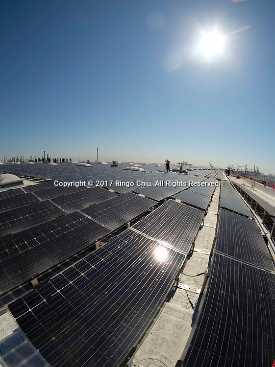 The newly completed 16.4-megawatt AC Westmont Solar Rooftop project, the most powerful solar rooftop installation in the world, Monday June 26, 2017 in Los Angeles. The 2 million-square-foot rooftop solar array will produce enough clean energy to power 5,000 Los Angeles homes, and in the process eliminate carbon emissions equivalent to taking 6,000 cars off the streets. (Photo by Ringo Chiu)<br /> <br /> Usage Notes: This content is intended for editorial use only. For other uses, additional clearances may be required.
