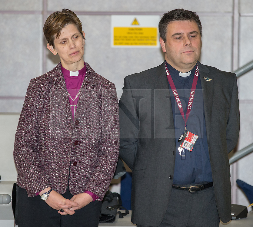 © Licensed to London News Pictures . 09/02/2015 . Manchester , UK . Wife and husband Libby Lane ( Bishop of Stockport) and George Lane ( pastor at Manchester Airport . Bishop Libby Lane carries out her first public engagement since being ordained as the first woman Bishop in the Church of England . Bishop Libby Lane meets victims of human trafficking at Manchester Airport's Terminal 2 Arrival Lounge and speaks in support of efforts to clamp down on human trafficking . Photo credit : Joel Goodman/LNP