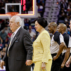 April 19, 2012; New Orleans, LA, USA; New Orleans Hornets and Saints owner Tom Benson and his wife Gayle Benson walk off the court at halftime of a game against the Houston Rockets at the New Orleans Arena.   Mandatory Credit: Derick E. Hingle-US PRESSWIRE