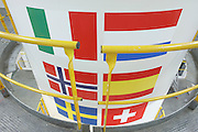 Member country flags on Ariane 5 rocket booster in Europropulsion's Booster Integration Building at European Space Agency..