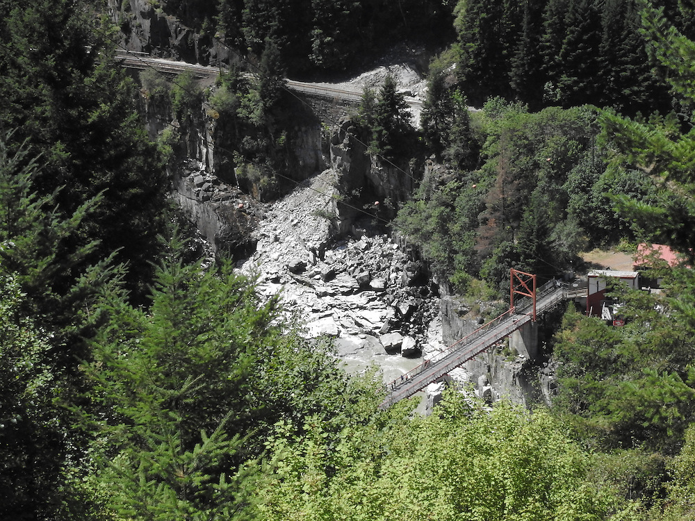 In the souhern end of Fraser Canyon, the waters of the Fraser River narrow to 115 feet, creating a magnificent rush of water known as Hell's Gate.  Long a salmon fishing area, the gorge also provides a dramatic backdrop for an aerial tramway which is capable of providing passage for 530 passengers per hour to the waters below. Photo by Alan Cradick.