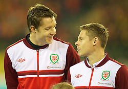 BRUSSELS, BELGIUM - Tuesday, October 15, 2013: Wales' goalkeeper Wayne Hennessey and Simon Church line-up before the 2014 FIFA World Cup Brazil Qualifying Group A match against Belgium at the Koning Boudewijnstadion. (Pic by David Rawcliffe/Propaganda)