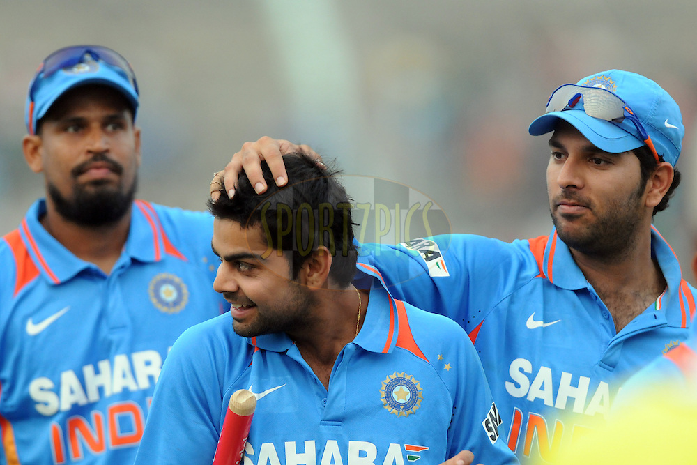 Yuvraj singh of India celebrates the win with teammate Virat Kohli of India during the 1st ODI (One Day International) held at the Nehru Stadium in Guwahati, Assam, India on the 28 th November 2010.Photo by Pal Pillai/BCCI/SPORTZPICS