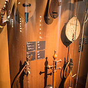 Various stringed instruments on display at the Musical Instrument Museum in Brussels, including a Bulgarian Gouslitsa (1912)  (top center), and Kamantcha from the Caucases (1883) (bottom middle), and a Gousla. The Musee des Instruments de Musique (Musical Instrument Museum) in Brussels contains exhibits containing more than 2000 musical instruments. Displays include historical, exotic, and traditional cultural instruments from around the world. Visitors to the museum are given handheld audio guides that play musical demonstrations of many of the instruments. The museum is housed in the distinctive Old England Building.