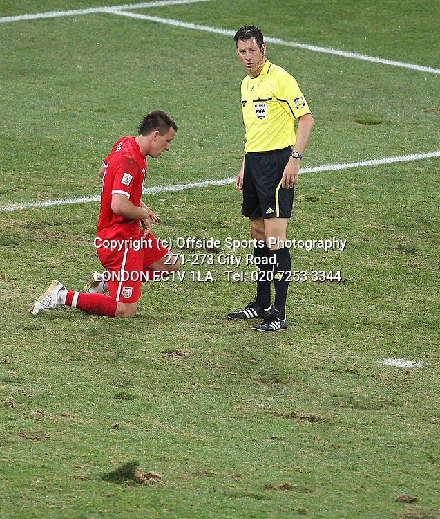23/06/2010 World Cup. Slovenia v England.<br /> Referee Wolfgand Stark checks on John Terry after he had blocked 2 Slovenian shots in the penalty area.<br /> Photo: Mark Leech.