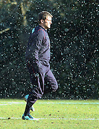 10 Feb 2010 Pennyhill Park, Bagshot, UK: Mark Cueto of England warms up in a sudden snow shower during the England rugby team training camp prior to the match against Italy. (Photo © Andrew Tobin www.slikimages.com)
