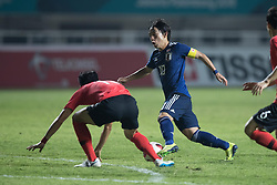 BOGOR, Sept. 1, 2018  Miyoshi Koji (C) of Japan competes during the men's football final between South Korea and Japan at the 18th Asian Games in Bogor, Indonesia on Sept. 1, 2018. (Credit Image: © Wu Zhuang/Xinhua via ZUMA Wire)